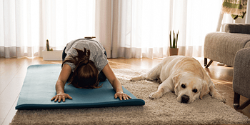 Dog next to owner working out