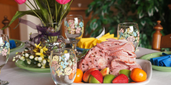 easter ham on decorated dinner table