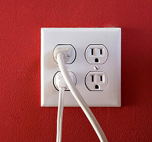 electrical-outlets-with-four-spaces-and-two-of-them-have-chords-plugged-in_BFrt-uCBs