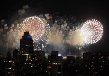 fireworks and smoke over city skyline