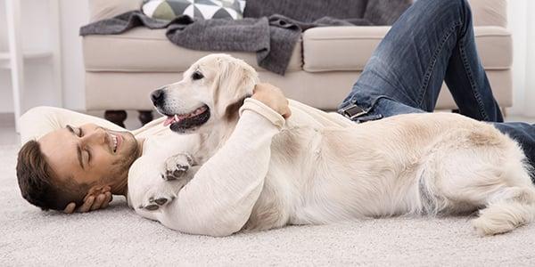 man-cuddling-with-dog-600