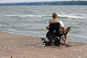man-fishing-with-dog