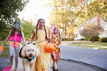 Dog and kids in costume